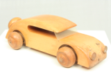 Car made of beech called the automobil sedan. Design and production by Kay Bojesen, Denmark.
