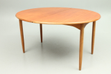 Dining table in teak and oak. Designed and produced in Denmark around 1950.